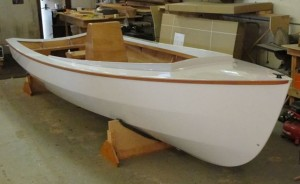 PT Skiff painted with mahogany rub rail